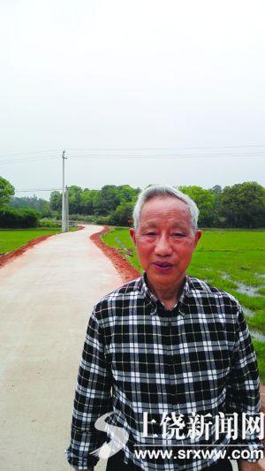 退休教师矢志为家乡修路 羊肠小道变5.5米宽公路